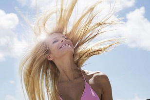 Smiling woman tossing her hair